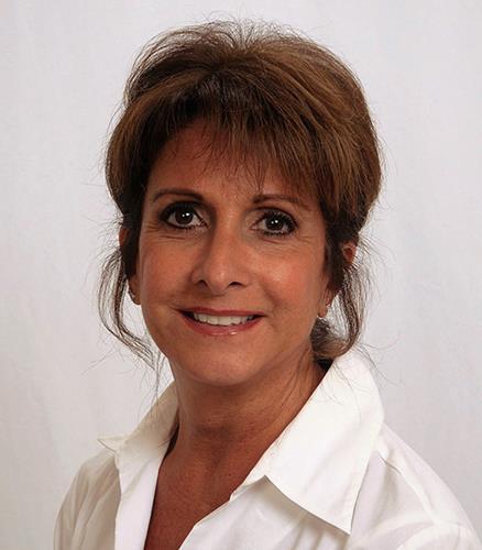 Joan Coronis  Agent